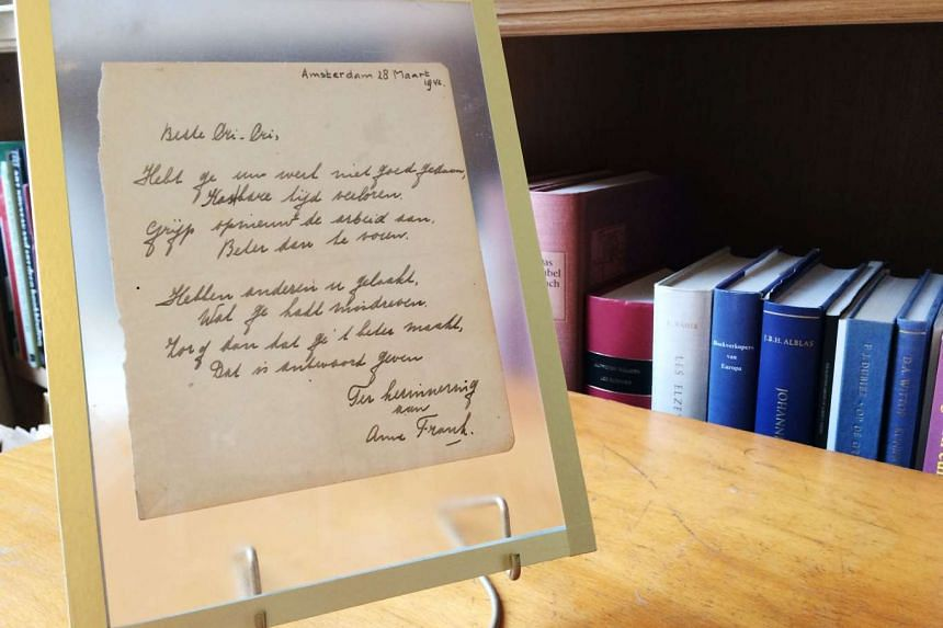 """An """"extremely rare"""" handwritten poem by Anne Frank, penned shortly before she went into hiding from the Nazis, is to be auctioned on November 23. The poem was written in the friendship book of the older sister of Frank's best friend, and is signed by"""