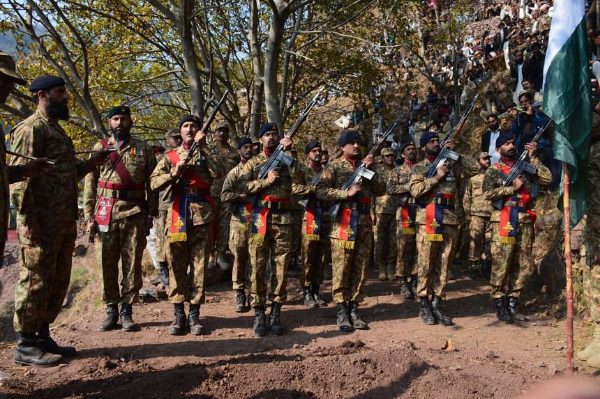 Pakistani Army soldiers attend a funeral ceremony of their comrade Havaldar Ibrar Ahmad Awan on Nov 15, who was killed during clashes across the Line of Control, the defacto border between Pakistani and Indian-administered Kashmir. Tensions between t