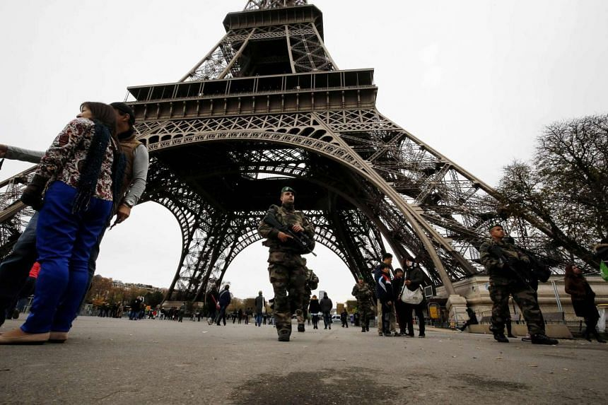 French soldiers patrolling the area at the foot of the Eiffel Tower in Paris.