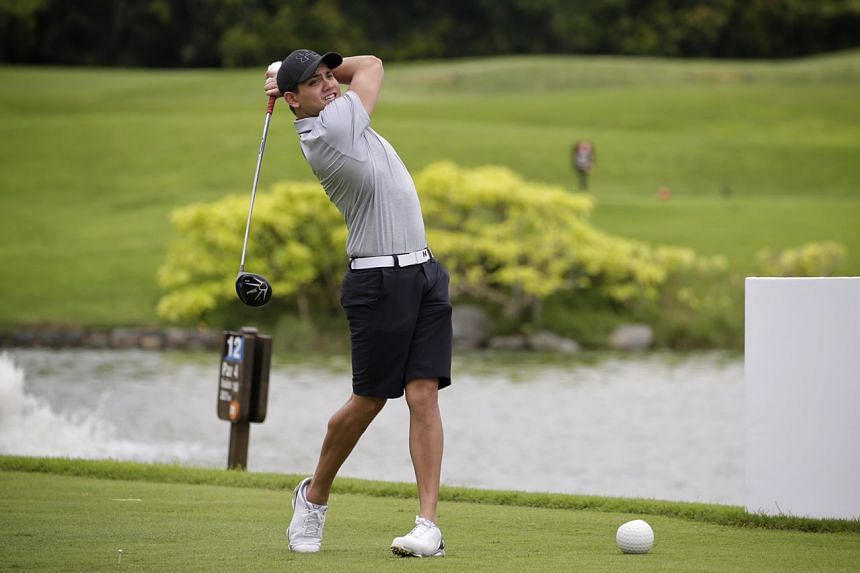 Olympic champion Joseph Schooling during a golf fund-raiser at Tanah Merah Country Club organised by the Singapore Swimming Association on Tuesday (Nov 22).