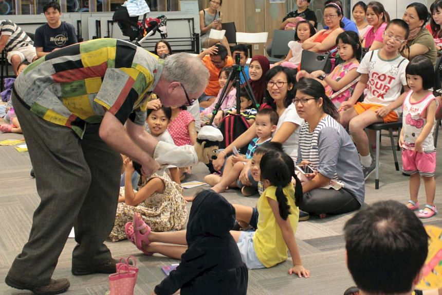 Roger Jenkins telling the story of The Cake Of Happiness at Toa Payoh Library earlier this month.