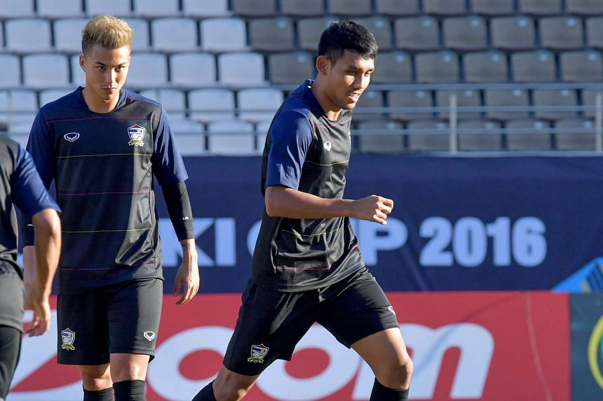 Thailand footballers Teerasil Dangda (right) and Charyl Chappuis during a training session at the Philippines Sports Stadium yesterday. Teerasil starred with a hat-trick in his side's 4-2 win against Indonesia in the opening match of the AFF Suzuki