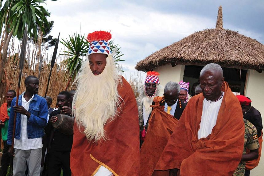 The Omukama of Toro, Rukirabasaija Oyo Nyimba Kabamba Iguru Rukiidi IV, known as King Oyo, takes part in a traditional procession after reading a message from USAID in his capacity as Ambassador to Africa for the fight against HIV/Aids on Sept 17, 20
