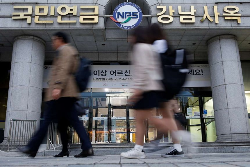 People walk past a branch office of the National Pension Service (NPS) in Seoul.