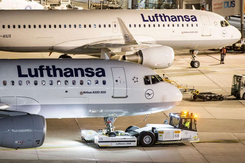 Germany's flagship carrier Lufthansa said it would cancel nearly 900 flights on Nov 23 because of a strike by pilots, causing travel disruptions for tens of thousands of passengers in the latest escalation of a long-simmering pay dispute.