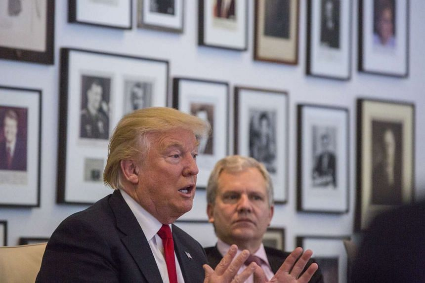 President-elect Donald Trump during a meeting with Arthur Sulzberger Jr (right) publisher of the New York Times, along with reporters, editors and columnists from the paper, at the Times building in New York, Nov. 22, 2016.