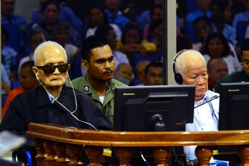 Former Khmer Rouge leader Nuon Chea (left) and former Khmer Rouge head of state Khieu Samphan (right) sitting in the courtroom at the Extraordinary Chambers in the Courts of Cambodia in Phnom Penh.