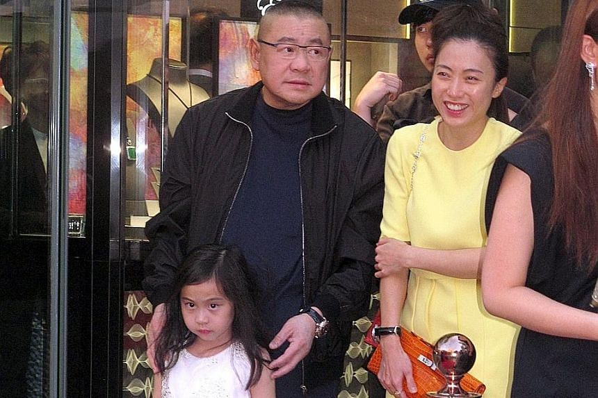 Hong Kong's fifth richest man Joseph Lau (above) with Ms Kimbie Chan and their daughter, Josephine, in Hong Kong in 2014.