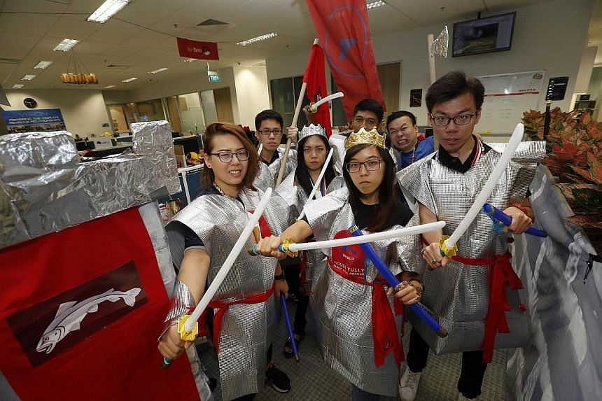 The House It Going sales team at ServiceSource comprises (from far left) Ms Jolene Chin, Mr Samuel Quek, Ms Roxanne Tiang, Mr Hazwan Aziz, Ms Melanie Tay, Mr Max Lem and Mr Kenny Ng.