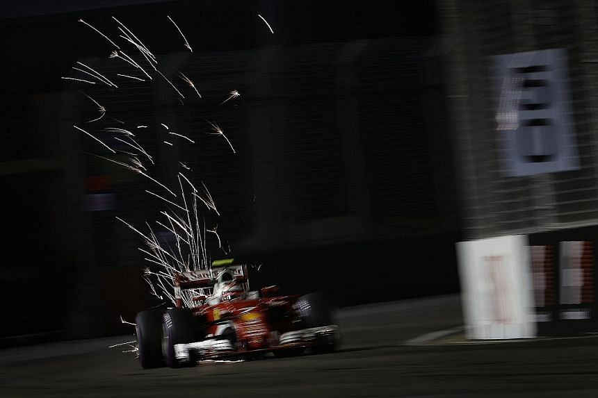 Scuderia Ferrari driver Kimi Raikkonen (above left) at the 2016 Formula One Singapore Airlines Singapore Grand Prix in September. Earlier this week, F1 supremo Bernie Ecclestone (left) had suggested Singapore could be leaving the race stable, before