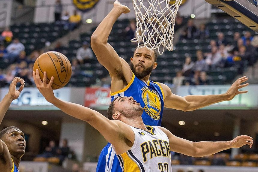 Golden State Warriors centre JaVale McGee blocking Indiana Pacers forward Georges Niang's attempt for an easy two points from under the rim. Golden State beat Indiana 120-83 with coach Steve Kerr purring over the number of rejections his team dished