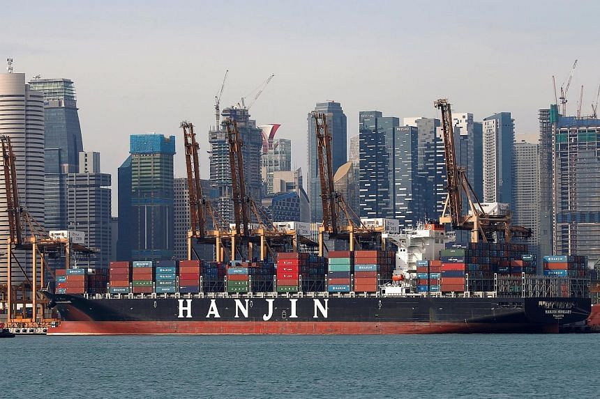 A Hanjin container ship docked at PSA's Tanjong Pagar terminal. The bankrupt South Korean shipping line is selling part of its container business for $44.7 million - although this represents only a small portion of the $1.1 billion total claims by cr