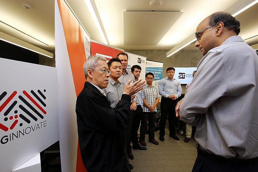 DPM Tharman with Dr Wong Poh Kam, director for NUS Entrepreneurship Centre and professor at NUS Business School, and other SGInnovate partners at the launch yesterday. Mr Tharman spoke about the need to create value through innovation.