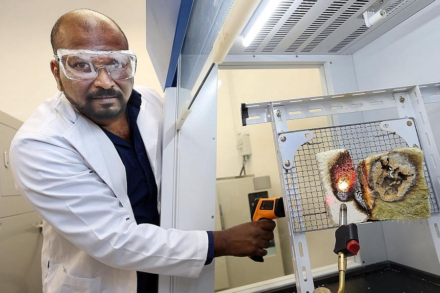 Dr Mahesh demonstrating the fire resistance of NTU's newly developed foam (left) over conventional insulating material (right) when put under a blowtorch flame at almost 2,000 deg C. NTU's innovation and enterprise arm NTUitive has filed a patent for