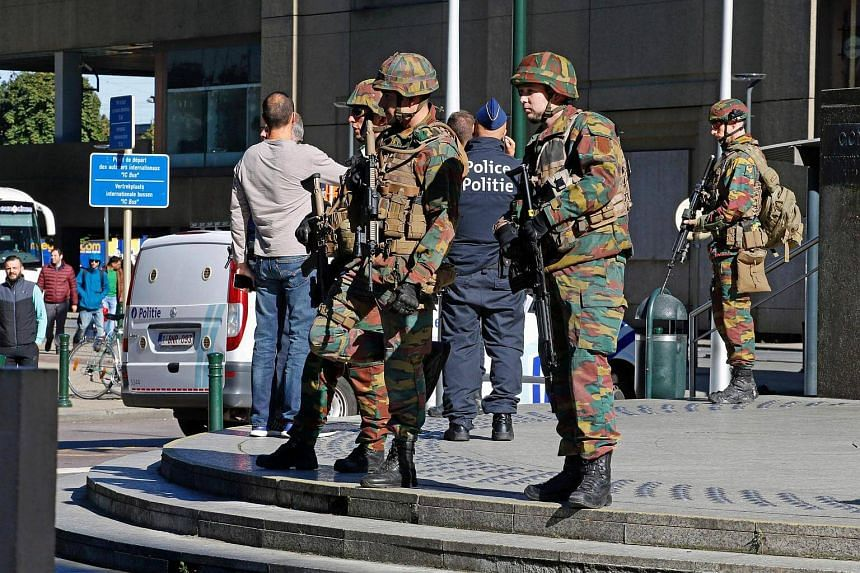 Police and army personnel stand guard during a bomb alert outside the Brussels-North train station in Brussels, on Oct 5, 2016.