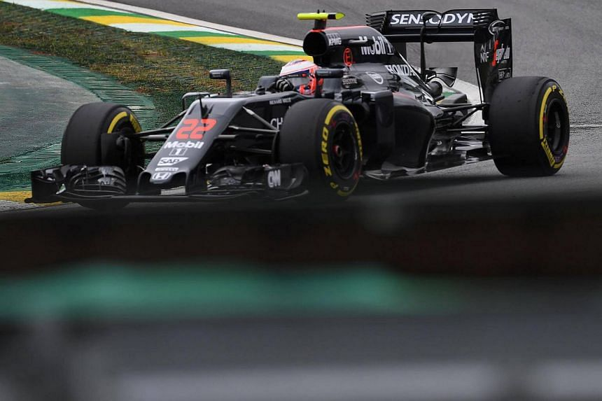 McLaren Honda's British driver Jenson Button powers his car during the third practice session of the Formula One Brazilian Grand Prix.