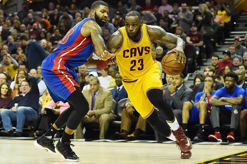 Cleveland Cavaliers forward LeBron James drives on Detroit Pistons forward Marcus Morris during the second half at Quicken Loans Arena.
