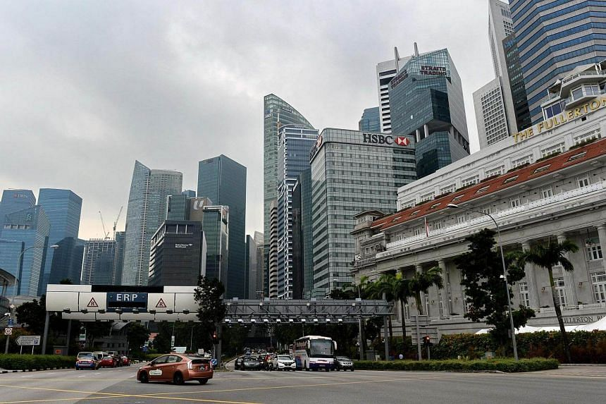 Motorists stop at a junction as the Raffles Place financial business district is seen in Singapore on Sept 27, 2016.