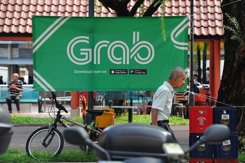 An advertisement for private-hire car service Grab at Bukit Merah View Market and Food Centre.