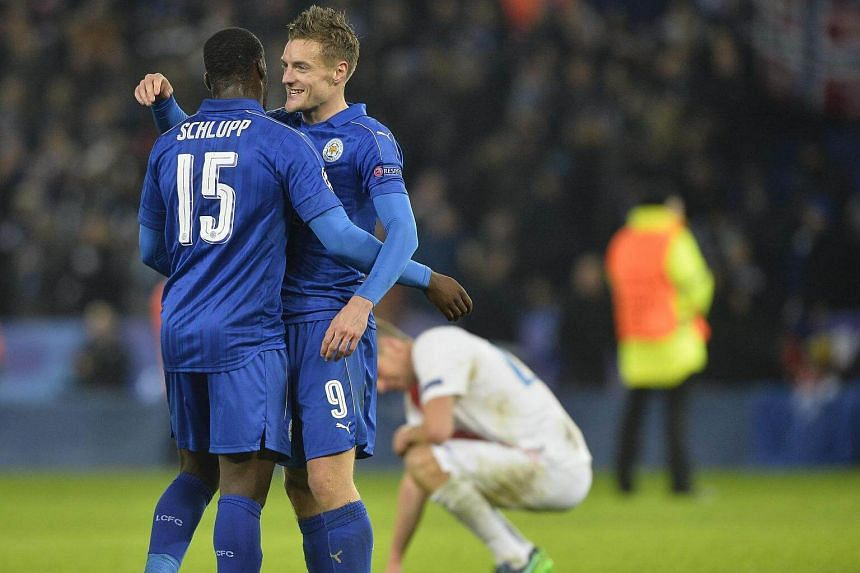 Jamie Vardy (right) and Jeff Schlupp (left) of Leicester City react after the Uefa Champions League group G football match between Leicester City and Club Brugge at the King Power Stadium.