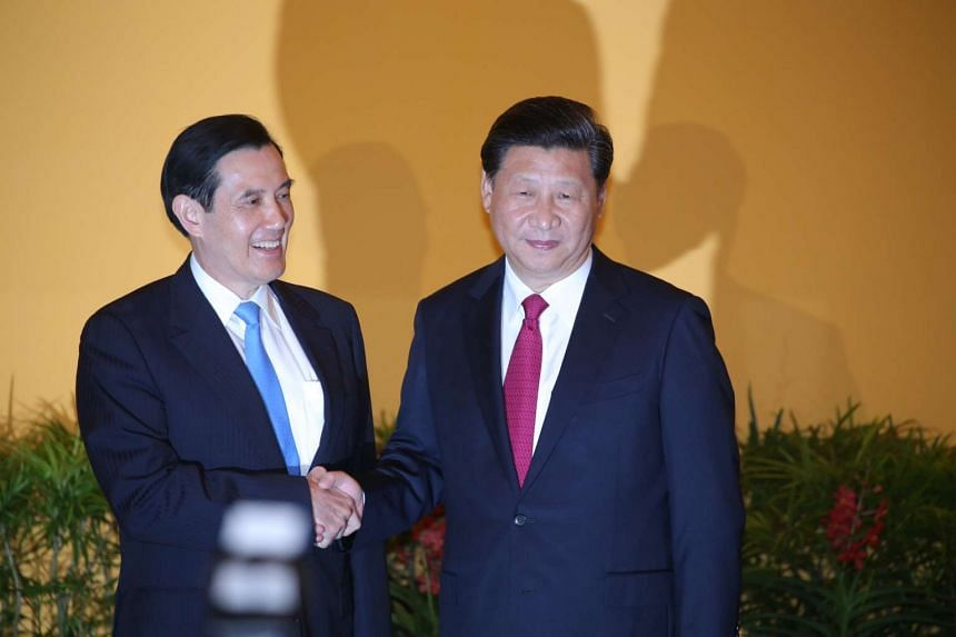 Former Taiwanese president Ma Ying-jeou shakes hands with Chinese President Xi Jinping at the Shangri-La Hotel on Nov 7, 2015.