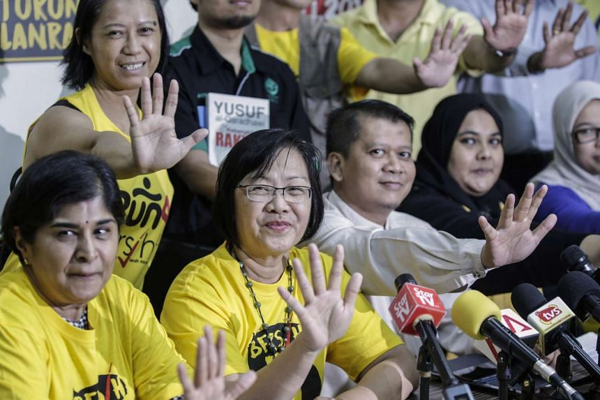 Bersih 2.0 Chairman Maria Chin Abdullah (second from left) and her comittee wave during the Bersih 5.0 rally press conference at Kuala Lumpur, Malaysia on Nov 17, 2016.
