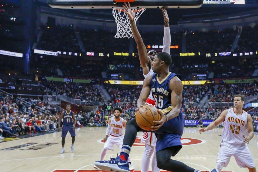 New Orleans Pelicans' guard E'Twaun Moore (centre) drives under the basket during the second half of their NBA basketball game against the Atlanta Hawks on Nov 22, 2016.
