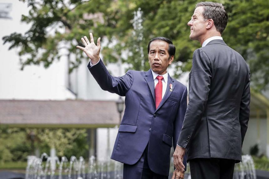 Dutch Prime Minister Mark Rutte (right) listens to Indonesia's President Joko Widodo during a meeting at Merdeka Palace in Jakarta on Nov 23, 2016.