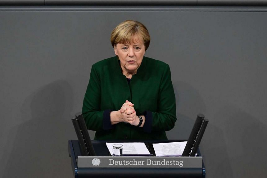 German Chancellor Angela Merkel gestures as she gives a speech during a session at the Bundestag (lower house of parliament) on Nov 23, 2016 in Berlin.
