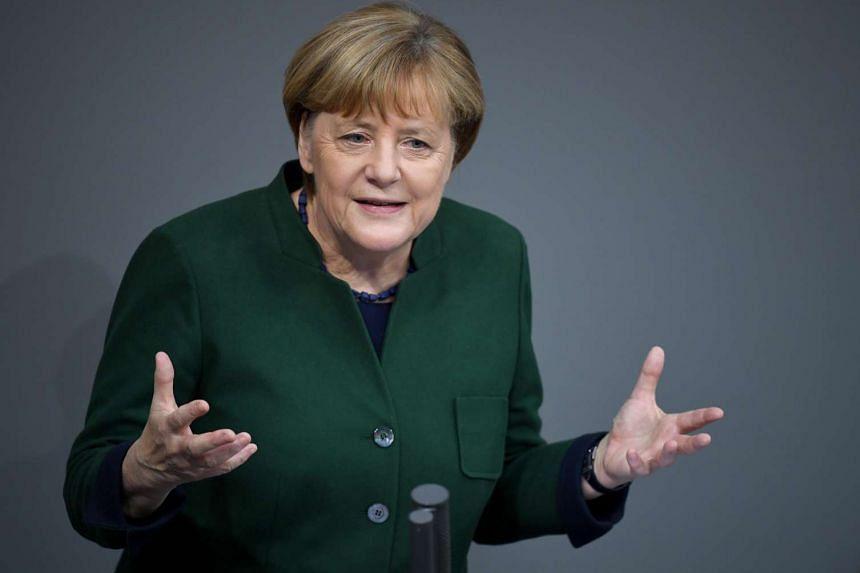 German Chancellor Angela Merkel speaks during the Bundestag in Berlin, Germany on Nov 23, 2016.
