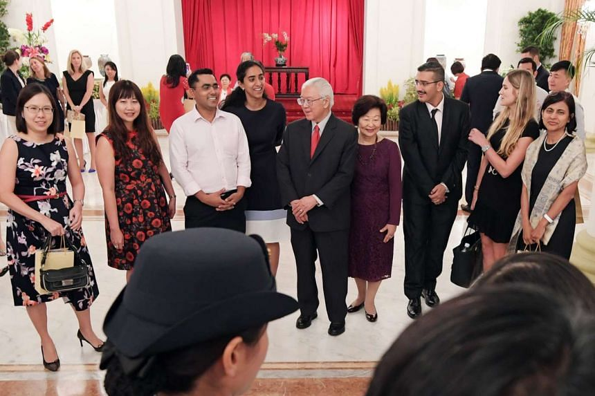 President Tony Tan and Mrs Tan mingle with guests at the President's Challenge 2016 Appreciation Night at the Istana on Nov 23, 2016.