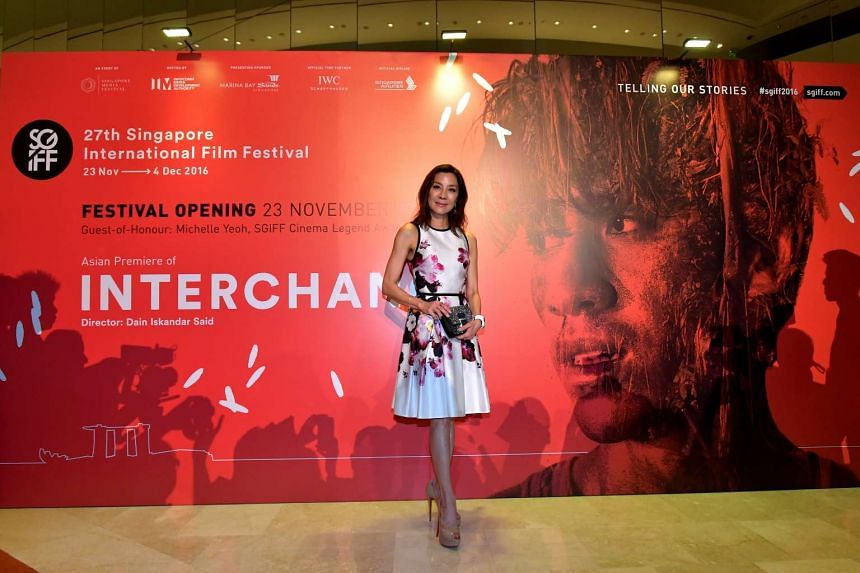 Michelle Yeoh poses for photos at the opening of the Singapore International Film Festival (SGIFF) at Sands Theatre, Marina Bay Sands on Nov 23, 2016.