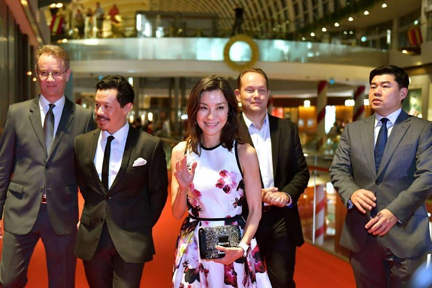 (From left) Mr George Tanasijevich. Mr Mike Wiluan, Michelle Yeoh, Mr Robert Gilby and Mr Gabriel Lim at the red carpet at the opening of the Singapore International Film Festival at the Sands Theatre, Marina Bay Sands on Nov 23, 2016.
