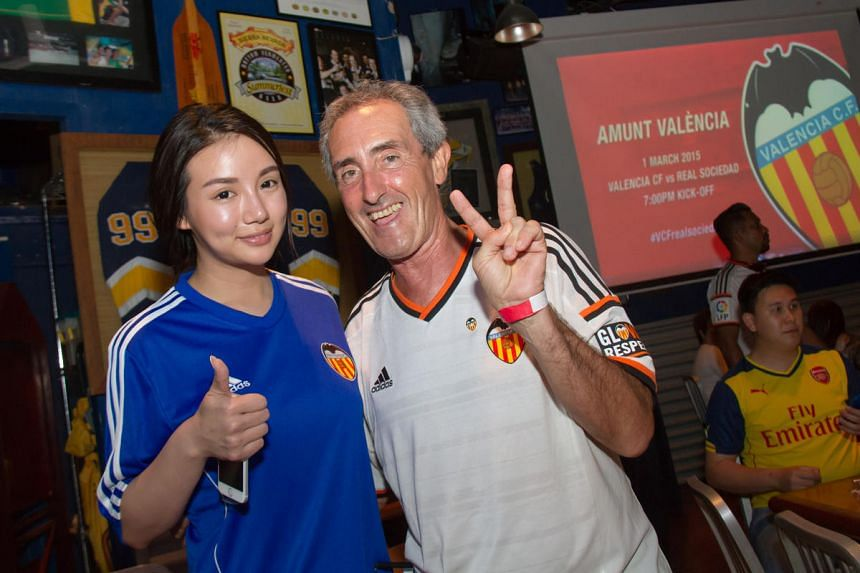 Kim Lim (left), daughter of Valencia owner Peter Lim, posing with a fan of the La Liga club Gustavo Hoyos on March 1, 2015.