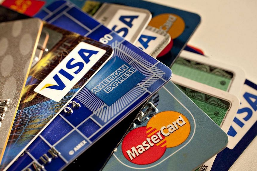 American Express, MasterCard and Visa credit cards are displayed for a photograph in New York, US.