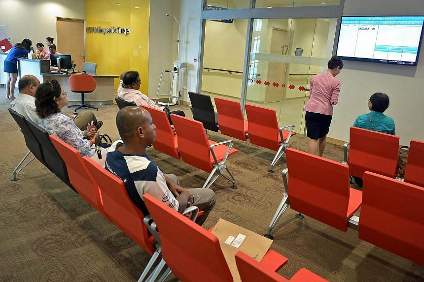Patients waiting for their turn to see doctors at the orthopaedic surgery department of the Ng Teng Fong General Hospital on June 30, 2015.