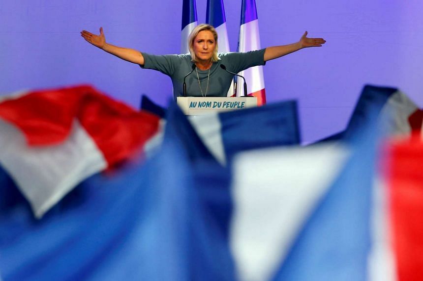 French National Front leader Ms Le Pen during a rally on Sept 18. A Le Pen presidency could lead to the collapse of the EU. She wants to pull France out of the euro and to hold a referendum on France's EU membership.