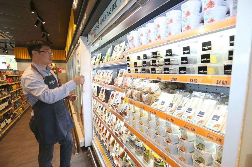 Mr James Kwan, creative director of Spinnaker360, a key shareholder of The Common Good Company, looking at the ready-to-eat range at the FairPrice Xpress at an Esso station in East Coast Road.