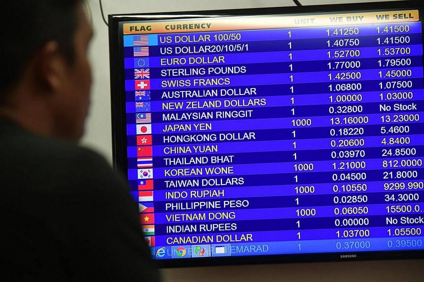 An electronic board informing customers that the Malaysian Ringgit is out of stock at a Change Alley money changer on Nov 14, 2016.