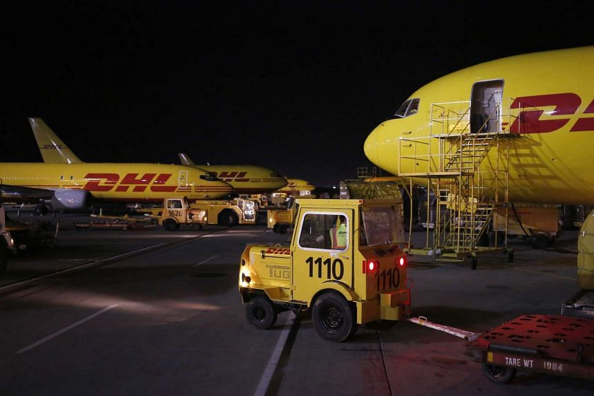 Cargo jets sit parked on the tarmac during the overnight sort at the DHL Worldwide Express hub of Cincinnati.