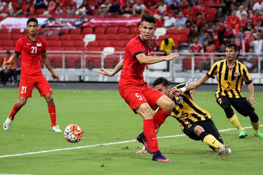 Baihakki Khaizan (second from left) in action during the match between Singapore and Malaysia at the Causeway Challenge at National Stadium on Oct 7, 2016.