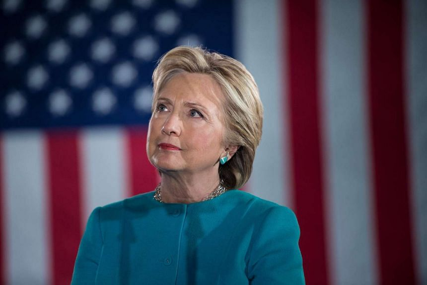 Clinton (above) has received 64,227,373 votes to Trump's 62,212,752 million, according to the Cook Political Report's latest tally.
