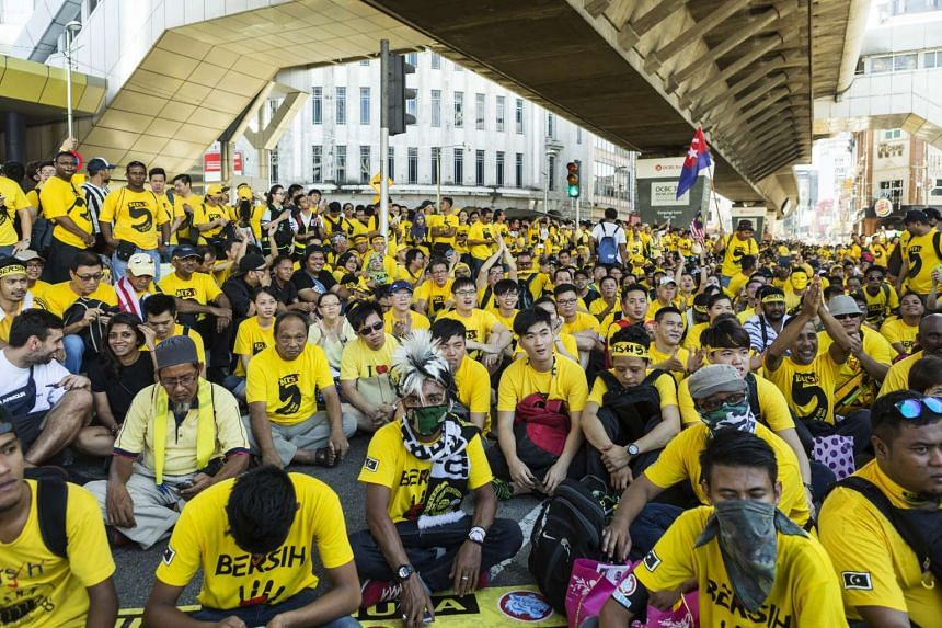 Protesters dressed in yellow gather near Merdeka Square during the Coalition for Clean and Fair Elections rally, also known as Bersih, in Kuala Lumpur, Malaysia, on Nov 19, 2016.