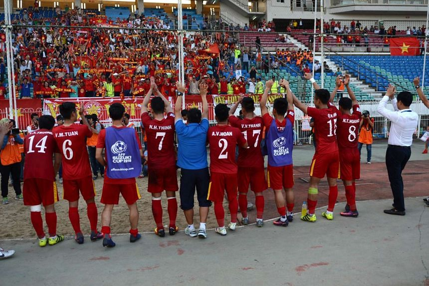 The Vietnam squad greets fans following their victory against the Malaysian team 1-0 during the AFF Suzuki Cup Group B soccer match in Yangon on Nov 23, 2016.