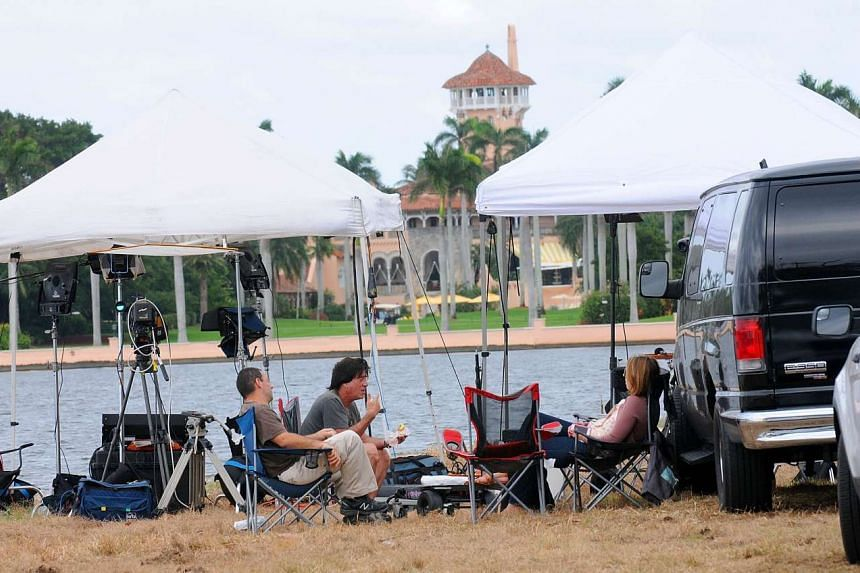 Members of the media wait outside the Mar-a-Lago Resort in Palm Beach, Florida, where President-elect Donald Trump will spend Thanksgiving, on Nov 23, 2016.