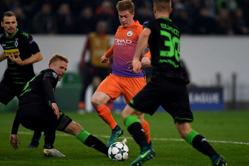 Moenchengladbach's Oscar Wendt and Manchester City's Kevin De Bruyne vie for the ball during the Uefa group C Champions League football match.