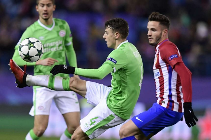 PSV Eindhoven's Santiago Arias (left) vies with Atletico Madrid's Saul Niguez during the Uefa Champions League Group D football match.