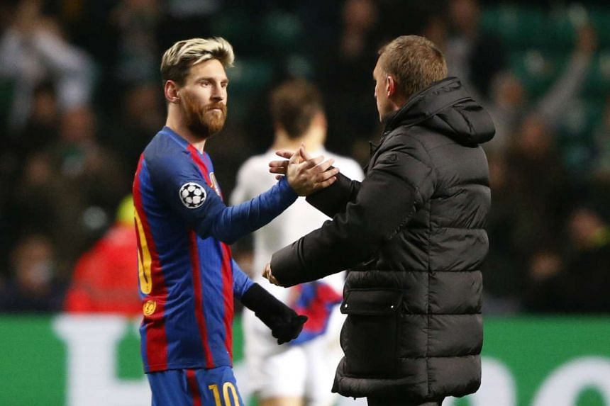 Barcelona's Lionel Messi and Celtic manager Brendan Rodgers shake hands after the match.