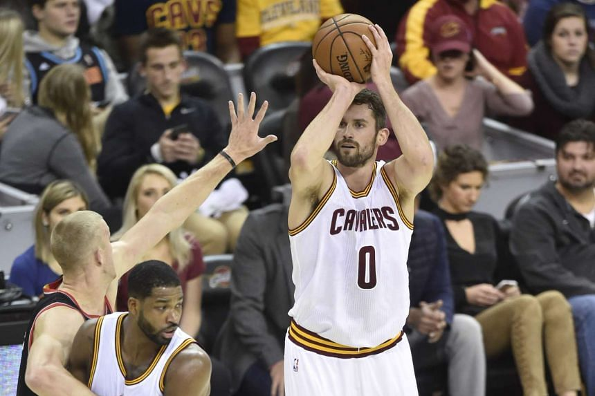 Cleveland Cavaliers forward Kevin Love makes a three point basket in the first quarter against the Portland Trail Blazers at Quicken Loans Arena on Nov 23, 2016.