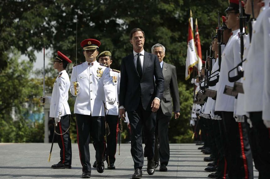 Dutch Prime Minister Mark Rutte (center) and Prime Minister Lee Hsien Loong inspecting honor guards during a welcome ceremony at the Istana Presidential Palace on Nov 24,